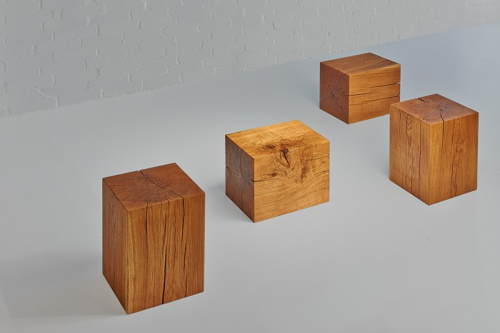The cube cut from an oak log shows knotholes and cracks as well as a lively grain.